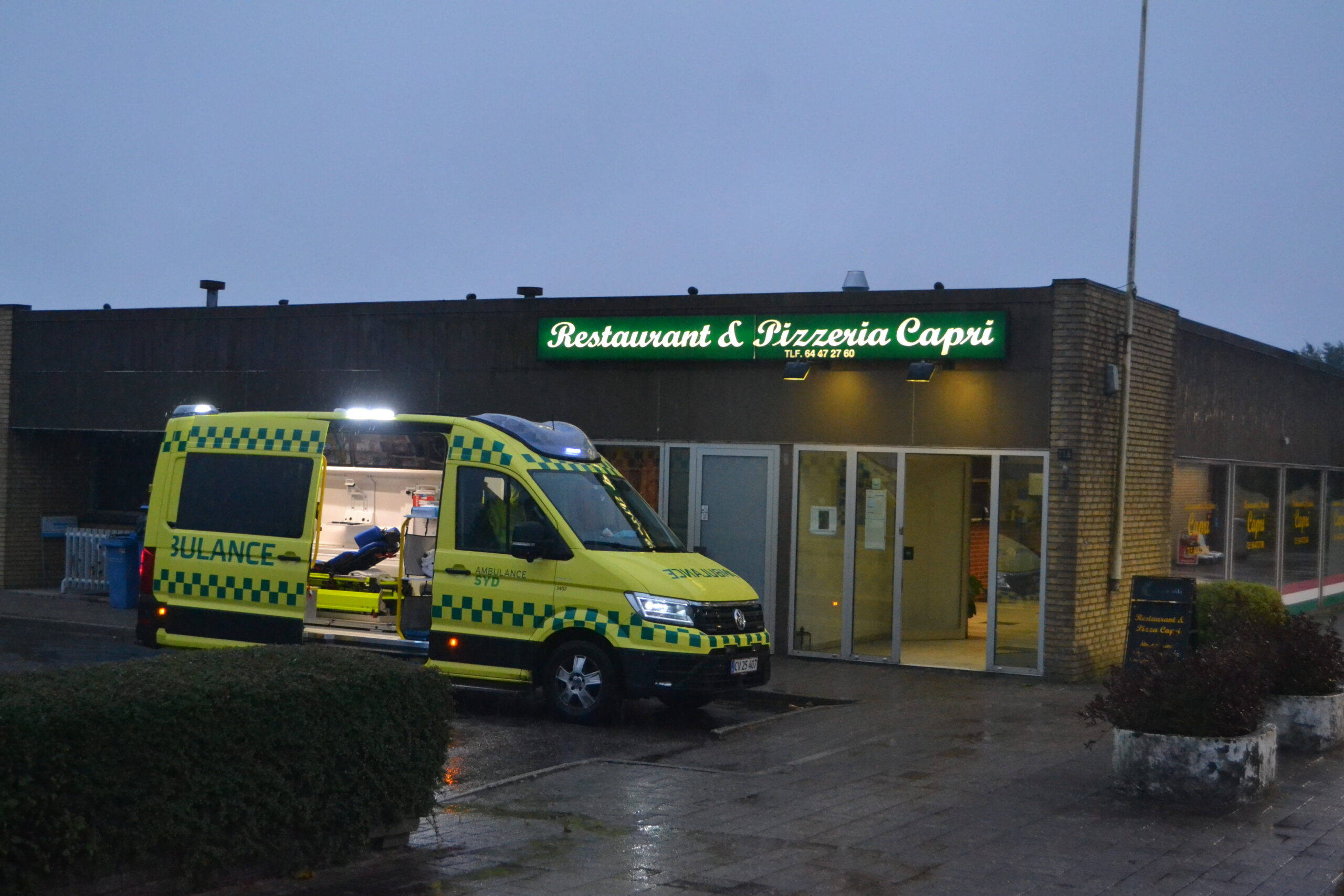 Person kollapset i pizzaria - ambulance er fremme